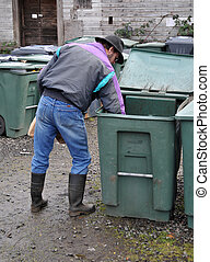 Man reaching in Recycle bucket - Man carefully placing glass...