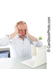 Man reacting in shock to his laptop