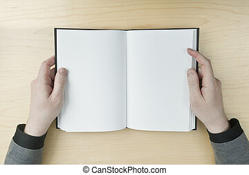 Man reading a blank book - Young male reading an empty open...