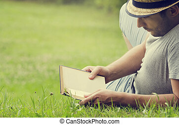 Man reading a book - Man reading a book on the grass