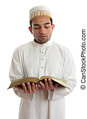 Man reading a religious or other book - Man wearing cultural...