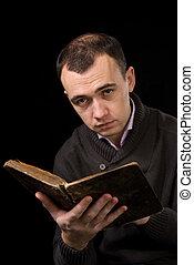 Man reading an antique book