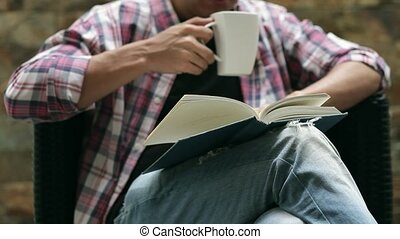 man reading and drinking coffee