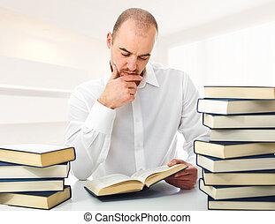 man reading at home