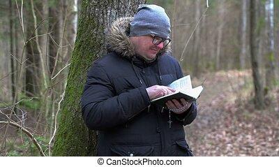 Man reading Bible at outdoor