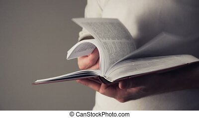 Man reading dictionary or book - Adult caucasian male...