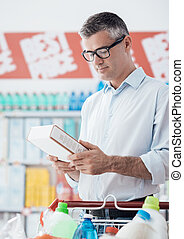 Man reading food labels