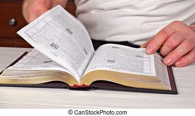 Man reading from the holy bible, close up