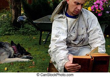 Man Reading In Garden
