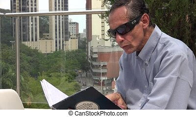 Man Reading in Urban Area