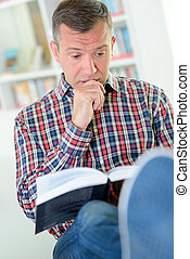 man reading interesting book