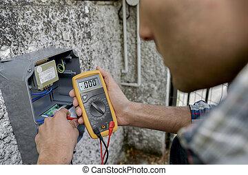 man reading meter