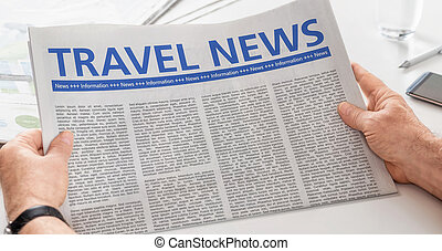 Man reading newspaper with the headline Travel News