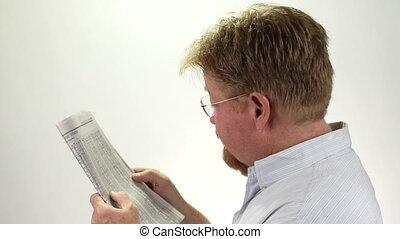 Man Reading Stock Market Report