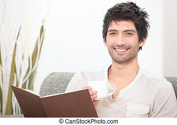 Man reading with coffee in hand