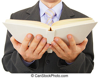 Man reads big book, isolated on white