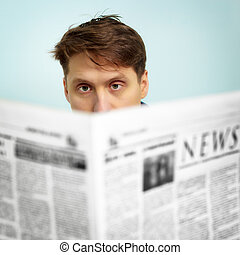 Man reads news in the newspaper