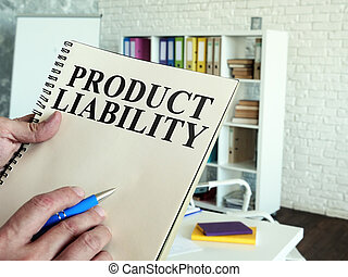 Man reads Product liability information indoors.