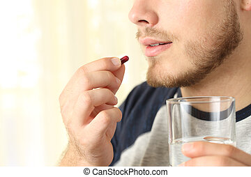 Man ready to swallow a pill - Close up of a man ready to...