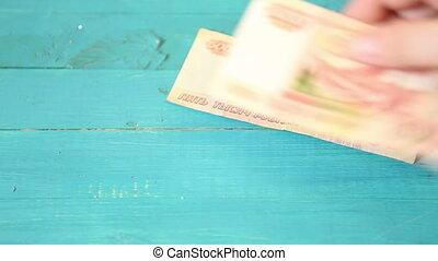 man recalculates paper money Russian ruble HD