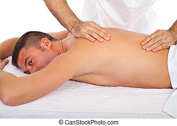 Man receive torso massage from a professional masseur in a...