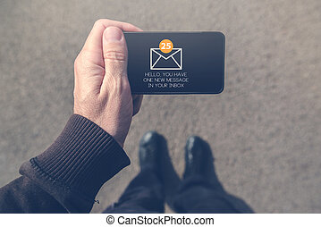 Man received e-mail message on mobile smartphone