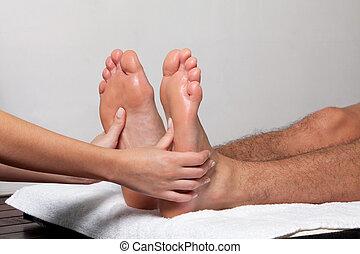 Man Receiving a Foot Massage - Man receiving a foot massage...