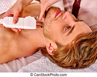 Man receiving electric facial peeling massage. - Man ...