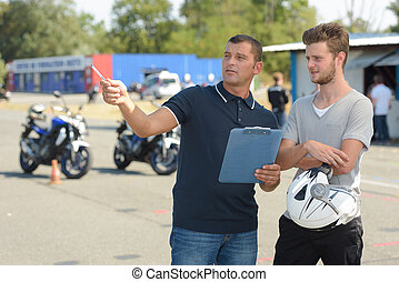 Man receiving instructions at motorcycle training course