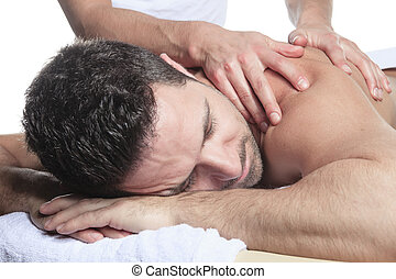 Man receiving Shiatsu massage from a professional masseur at...