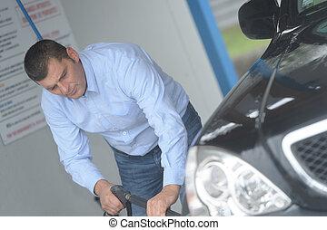 man refilling his car