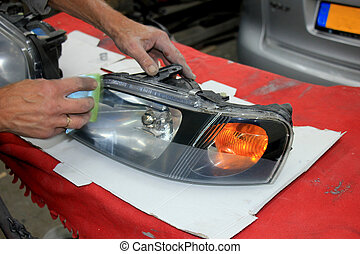 Man refurbishing car headlight - Man refurbishing a car...