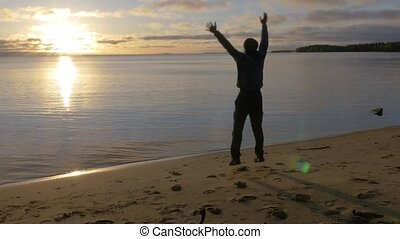 Man rejoices in the sun. He jumps from happiness. All just...