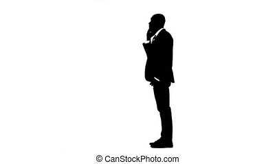 Man rejoices in the victory and speaks on the phone. White background. Silhouette