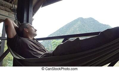 Man relax in a hammock