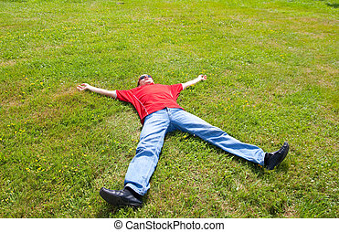 man relaxation - Man relaxation on a green grass