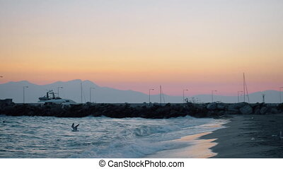 Man relaxing at the beach and evening scene of sea with...