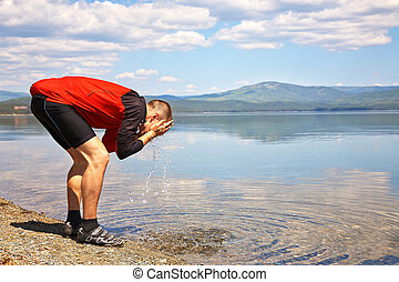 man relaxing at the lake