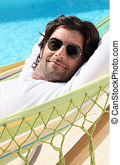 Man relaxing by the pool