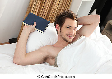 man relaxing in his bed