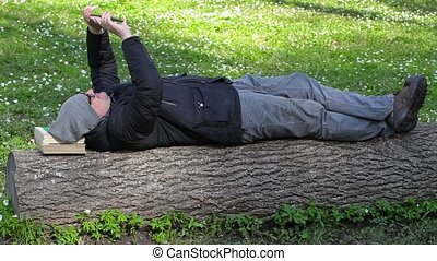 Man relaxing in meadow in the park
