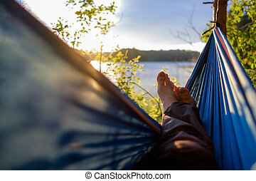 Man relaxing in the hammock.