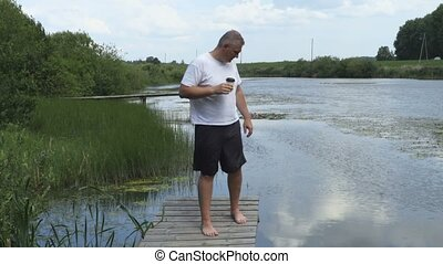 Man relaxing near pond