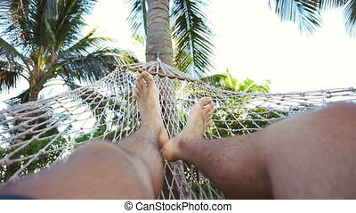 Man relaxing on the hammock