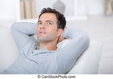 man relaxing on the sofa at home