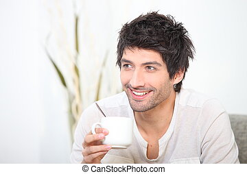 Man relaxing with a hot drink
