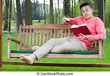 Man relaxing with book and coffee