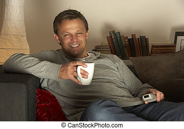 Man Relaxing With Coffee And Television