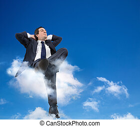 man relaxing with head in the cloud