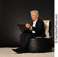 Man relaxing with laptop